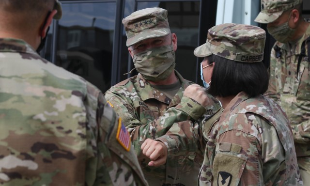 The Commanding General of the Army Materiel Command (AMC), Gen. Edward M. Daly greets Soldiers in the 1st Cavalry Division Sustainment Brigade's Operation Pegasus Harvest motor pool at Fort Hood, TX, July 30. The operation targets equipment readiness by reducing excess and costs. (U.S. Army photo by Pvt. Brayton Daniel)