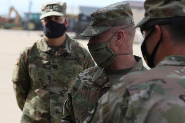 Capt. Miguel J. Denis, lead officer for the 1st Cavalry Division Sustainment Brigade's Operation Pegasus Harvest, stands by while Gen. Edward M. Daly, commander, Army Materiel Command and Col. Patrick A. Disney, commander, 1st Cav. Div. Sust. Bde., begin their walk through of the operation's motor pool on Fort Hood, TX, July 30. Denis says the operation consolidates the division's excess equipment to improve readiness and prepare the First Team for modernization. (U.S. Army photo by Pvt. Brayton Daniel)