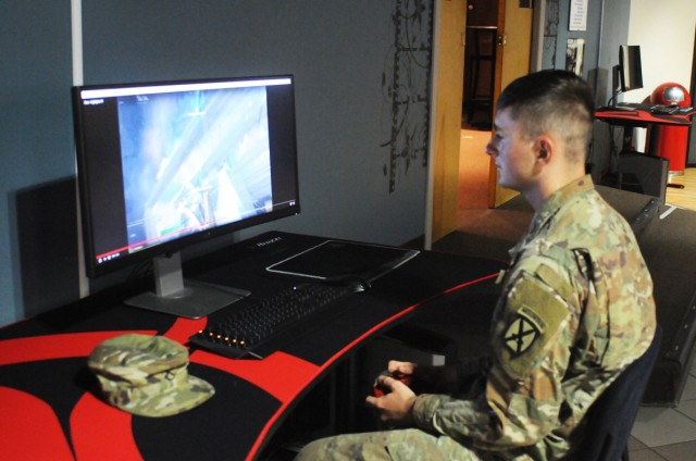 Pfc. Timothy Cleghorn, 3rd Squadron, 89th Cavalry Regiment, 3rd Brigade Combat Team, 10th Mountain Division, shows off his Fortnite playing skills at the Better Opportunities for Single Soldiers headquarters inside the Home of Heroes Recreation Center Aug. 13.