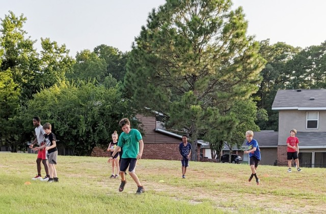 Neighborhood kids from Fort Polk's Dogwood terrace run various speed and conditioning drills under the directio nand supervision of Staff Sgt. (Coach) Johnathan Arnold, 2nd Battalion, 30th Infantry Regiment, 3rd Brigade Combat Team, 10th Mountain Division.