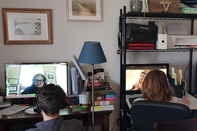 Two students who attend a Department of Defense Education Activity school in Vicenza, Italy, complete classwork from home through digital learning.