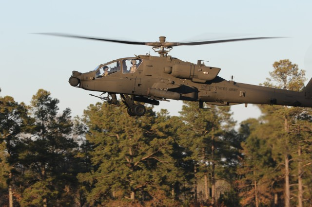 A U.S. Army AH-64D Apache Longbow prepares to engage targets during an aerial gunnery range exercise at Fort Bragg, North Carolina, Jan. 27, 2020. The 1,100-acre range has over 460 targets controlled by a team in the observation tower. (U.S. Army photo by Pfc. Joshua Cowden, 22nd Mobile Public Affairs Detachment)