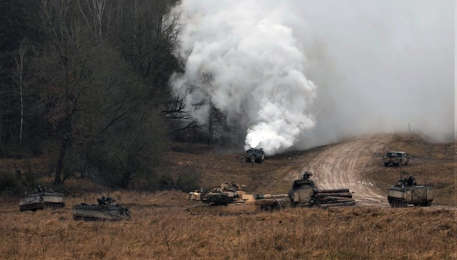 1st Battalion, 8th Cavalry Regiment, 2nd Armored Brigade Combat Team, 1st Cavalry Division, M1A2 Abrams tanks engages the enemy during force on force portion of the training exercise Combined Resolve XIII at the Joint Multinational Readiness Center in Hohenfels, Germany on Feb. 2, 2020. (U.S. Army National Guard photo by Staff Sgt. Gregory Stevens)