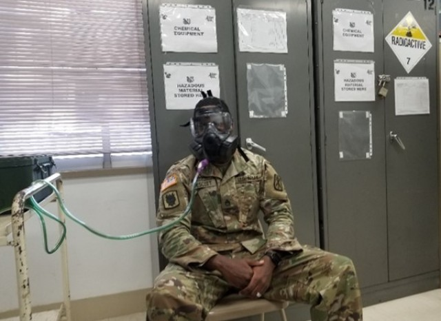 Staff Sgt. Felix Prescott uses the Protective Assessment Test System to ensure his field protective mask functions properly, in December of 2019.