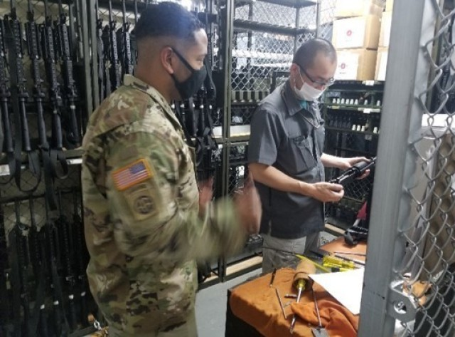 Sgt. Marcus Bahadur, USANEC-CZ Maintenance NCO, oversees annual weapon services performed by personnel of the Logistics Readiness Center for the 78th Signal Battalion on Honshu, Japan, in March of 2020.