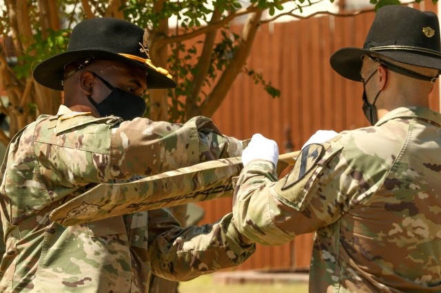 The 154th Composite Truck Company Commander, Capt. Anthony Alteri and company First Sergeant, 1st Sgt. Antwain Stokes, case the unit's guidon during a ceremony at the 1st Cavalry Division museum on Fort Hood, Texas, August 18, 2020. The company will deploy later this month to Kuwait, in support of Operation Spartan Shield, where they take on a transportation mission with a focus on heavy lift and long-haul operations throughout the CENTCOM area of responsibility. (U.S. Army photo by Sgt. 1st Class Ashleigh E. Martinez)