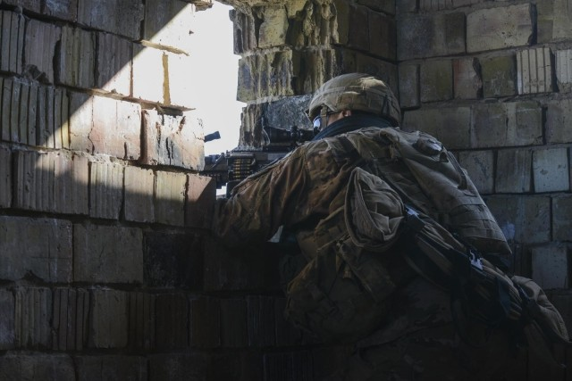 Soldiers with 1st Battalion, 8th Cavalry Regiment, 2nd Armored Brigade Combat Team train to clear a town alongside Hungarian Armed Forces during Hawk Strike in Hungary on March 5, 2020. Hawk Strike allows units to conduct movements in a realistic, high-intensity environment to ensure readiness for combat and the ability to fully integrate with NATO partners and allies. (U.S. Army National Guard photo by Staff Sgt. Noshoba Davis)