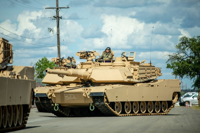 Troopers assigned to Bravo Company, 3rd Battalion, 8th Cavalry Regiment, 3rd Armored Brigade Combat Team (3ABCT), 1st Cavalry Division, stage the first set of new M1A2C (SEP v.3) Abrams Tanks at Fort Hood, Texas, July 21, 2020. The modernization of the Greywolf brigade, with the addition of receiving the new Abrams tanks, makes 3ABCT the most lethal and agile armored brigade in the Army. (U.S. Army photo by Sgt. Calab Franklin)