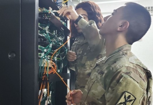 Network Support personnel of the USANEC – Camp Zama team install network devices at Hardy Barracks in Tokyo, Japan, in January of 2020.