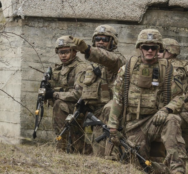 Soldiers with 1st Battalion, 8th Cavalry Regiment, 2nd Armored Brigade Combat Team train to clear a town alongside Hungarian Armed Forces during Hawk Strike in Hungary on March 3, 2020. Hawk Strike allows units to conduct movements in a realistic, high-intensity enivornment to ensure readiness for combat and the ability to fully integrate with NATO partners and allies. (U.S. Army National Guard photo by Staff Sgt. Noshoba Davis)