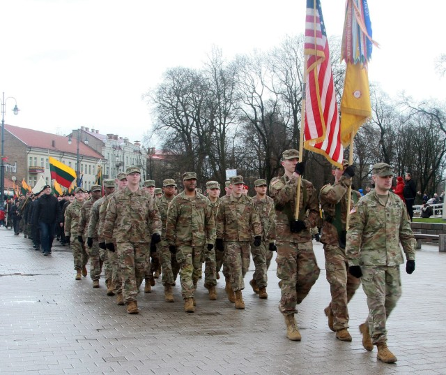 Soldiers with the 1st Battalion, 9th Cavalry Regiment, 2nd Armored Brigade Combat Team, 1st Cavalry Division, participating in the formal flag raising ceremony for the three Baltic States, and the Independence Day Parade, commemorating the restoration of Lithuanian independence of Lithuania at the Independence Square in Vilnius, Lithuania on March 11, 2020. (U.S. Army National Guard photo by Sgt. Megan Zander)