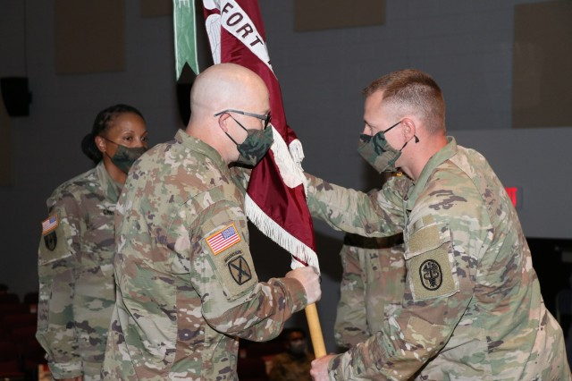1st Sgt. Jeremy E. Omealey passes the unit colors to Command Sgt. Maj. Jan E. Miller during the Raymond W. Bliss Army Health Center Change of Responsibility ceremony, Friday, Aug. 28. Command Sgt. Maj.