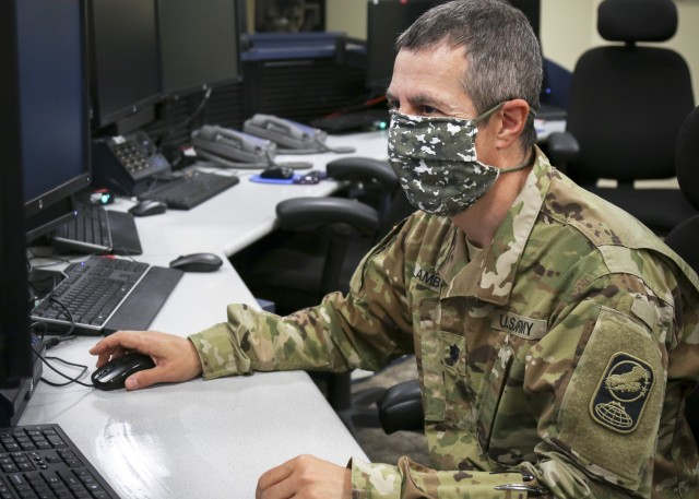 Army Lt. Col. George Lambos poses for a photo during his training to become recertified as a 100th Missile Defense Brigade crew director in the Missile Defense Integrations and Operations Center at Schriever Air Force Base in Colorado April 30, 2020. This is a title he held prior to a devastating car crash that nearly claimed his life. (Photo by Army Staff Sgt. Zach Sheely)