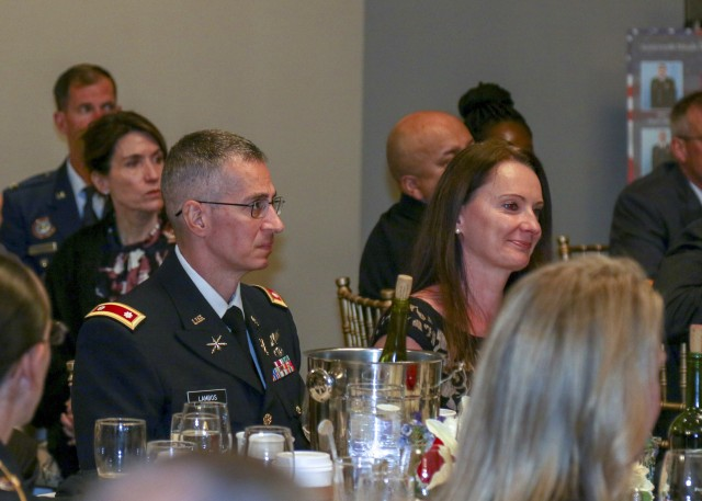Army Lt. Col. George Lambos and his wife, Margaret, listen to remarks given by Col. Christopher Williams during the 2019 Missile Defense Advocacy Alliance NORAD & USNORTHCOM Missile Warning and Defender of the Year ceremony at the Mining Exchange in Colorado Springs June 7, 2019. (Photo by Army Staff Sgt. Zach Sheely)