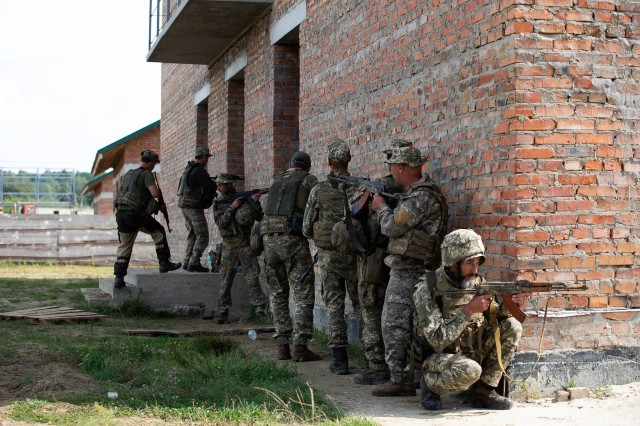 Armed Forces Ukraine soldiers practice urban operations under the guidance of their instructor, Aug. 26 at Combat Training Center-Yavoriv, Ukraine. (Photo by Sgt. Gregory Glosser, JMTG-U Public Affairs)