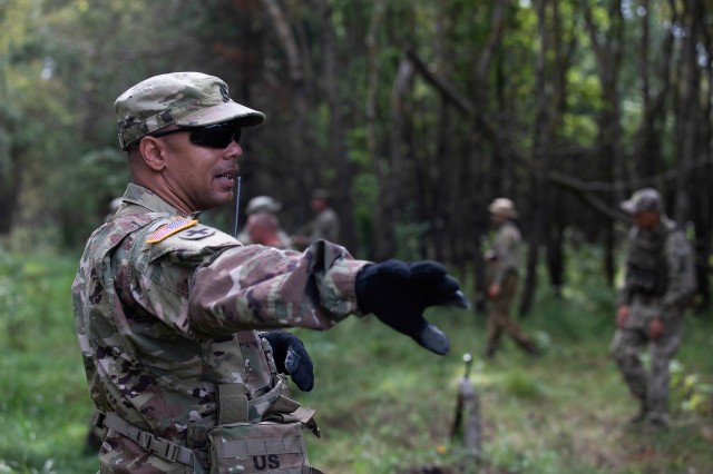 Sgt. 1st Class Theodore Durden oversees Armed Forces of Ukraine personnel as they practice detainee operations during company-level training exercises, Aug. 26, at Combat Training Center-Yavoriv, Ukraine.  (Photo by Cpl. Shaylin Quaid, JMTG-U Public Affairs)