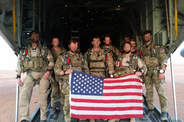 "Sgt. Maj. Thomas ""Patrick"" Payne, center, and his teammates prior to a military free fall jump in this undated photo. They hold the American flag to signify duty and devotion to country."