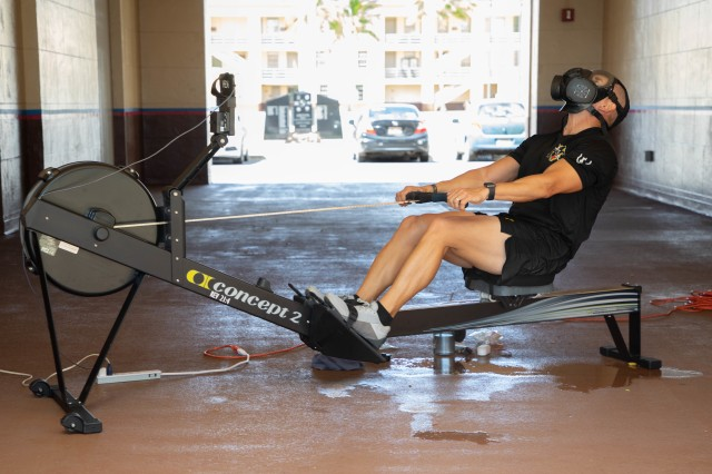 1st Sgt. Marc Dibernardo, Headquarters and Headquarters Company, 3rd Infantry Brigade Combat Team, 25th Infantry Division First Sergeant, rows 48,400 meters while wearing an M-50 Protective Mask in an effort to raise awareness for suicide prevention on August 27, 2020 on Schofield Barracks, Hawaii. (U.S. Army photo by Staff Sgt. Alan Brutus)