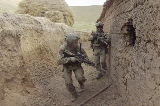 "Sgt. Maj. Thomas ""Patrick"" Payne during a 2011 raid in Afghanistan."