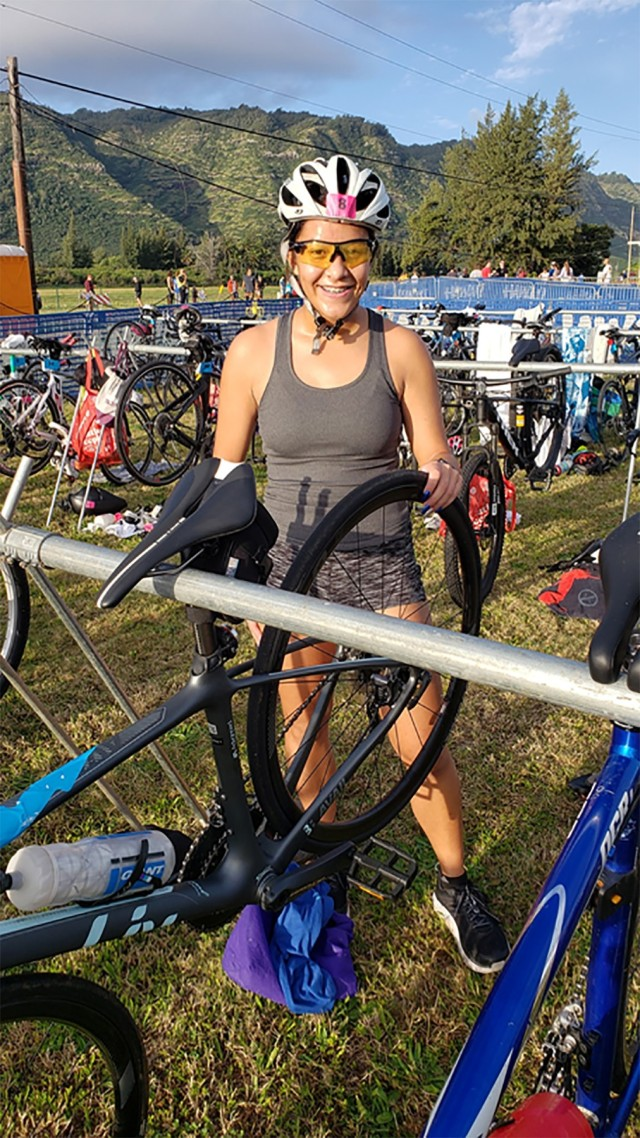 Noelani Tugaoen participates in her first triathlon as the bike person of a relay team in the Northshore Triathlon, March 2020