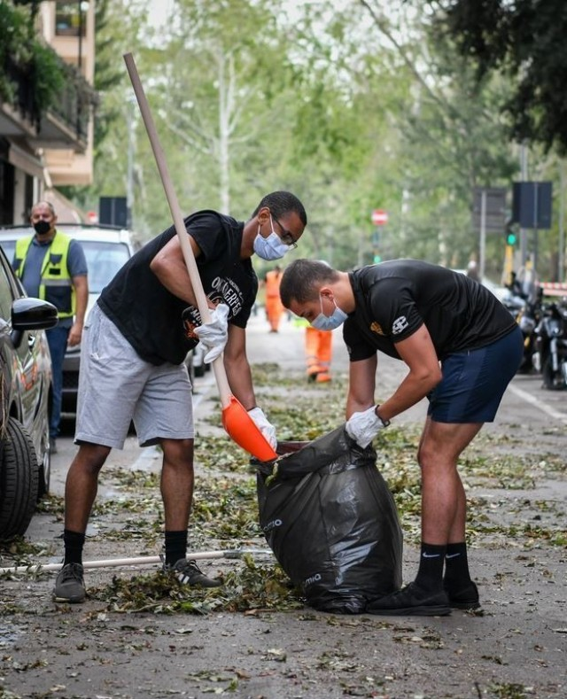 Soldiers from Dental Health Activity-Italy clean debris from the streets of Verona after a violent storm wreaked havoc on the city Aug. 23.