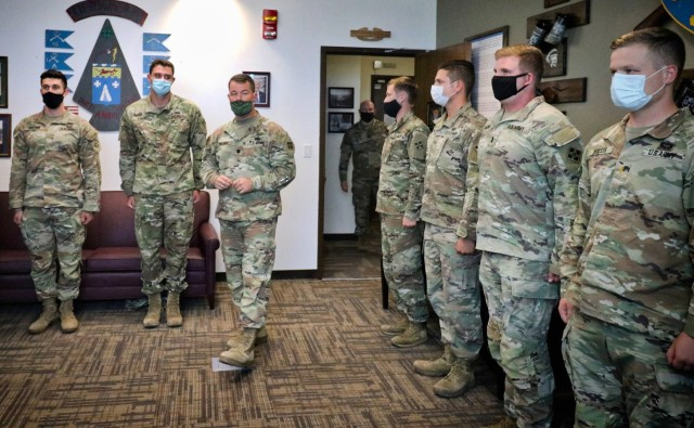 Lt. Col. Timothy Palmer (center), commander of 1st Battalion, 12th Infantry Regiment, 2nd Stryker Brigade Combat Team, 4th Infantry Division, briefs lieutenants with his battalion upon completion of the Platoon Leader Assessment Selection Program Aug. 28 at Fort Carson, Colorado. The program, first held July 2019 and unique to the battalion, assesses and prepares lieutenants in the battalion to be assigned to positions that will challenge them and set them up for success during their time in the battalion and the U.S. Army. (U.S. Army photo by Capt. Chelsea Durante)