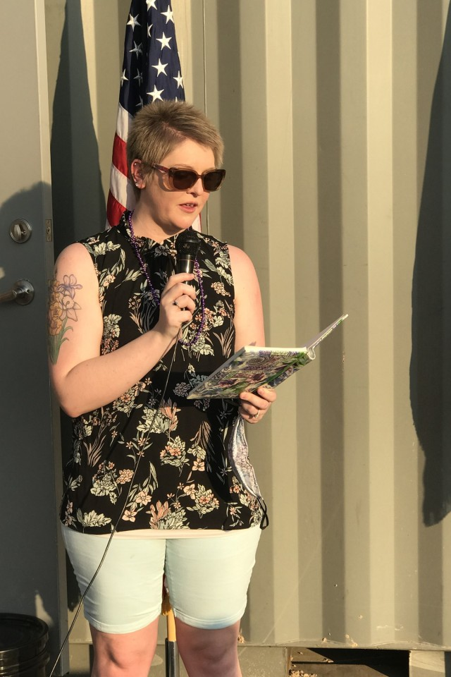 Caitlyn Clark, a military spouse with Weed Army Community Hospital, shares her story of survival during the Suicide Prevention Awareness Walk Sept. 1 at Fort Irwin, Calif. (U.S. Army photo by Lt. Col. Jacquelin Coleman-Adams, WACH)