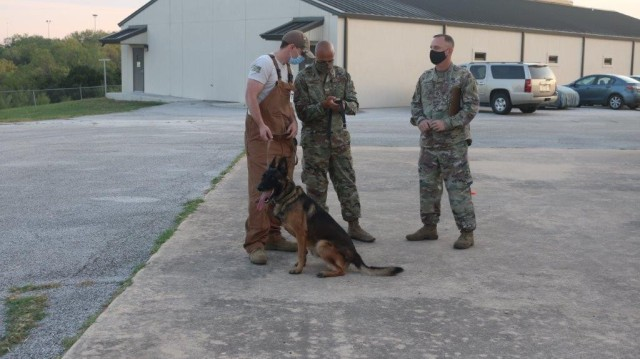 (From left to right) TSgt Luis Veliz (Kennel master) and SSgt Randy George (Military Working Dog Handler) operating the CMT mobile application prior to a canine work cycle, with SFC Jeremy Barbee (AMEDDBD Test Officer) overseeing operations.