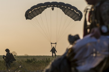 Soldiers perform an airborne operations jump from UH-60 Black Hawk helicopters at Fort Bragg, N.C., July 17, 2020.
