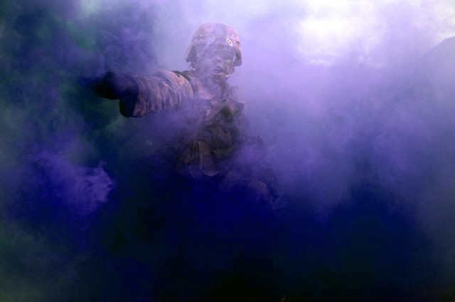 Army-funded research into sleep deprivation may help leaders assess the effects of sleep on mission accomplishment.  Spc. Alec Nitollama, 25th Infantry Division, directs his squad through smoke Aug. 30, 2019 at Schofield Barracks, Hawaii.