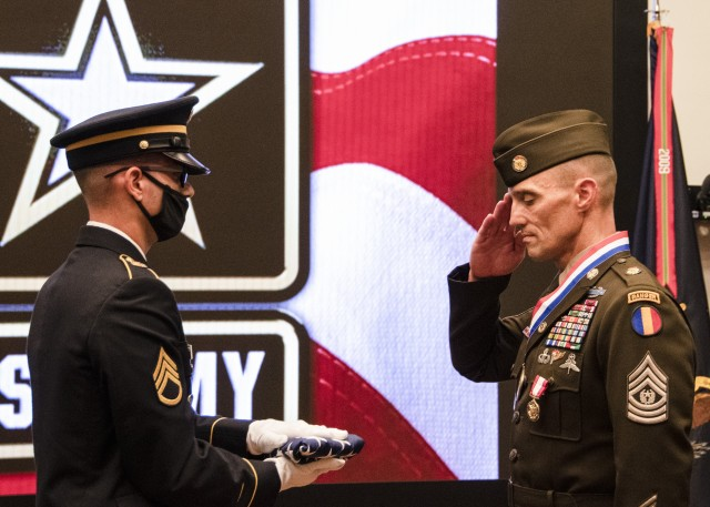Command Sgt. Maj. Timothy A. Guden (Ret. and Right), previous command sergeant major, U.S. Army Training and Doctrine Command, renders a salute to the flag that he received at his retirement ceremony Sept. 3, 2020, Fort Eustis, Virginia. (U.S. Army photo by David Overson)