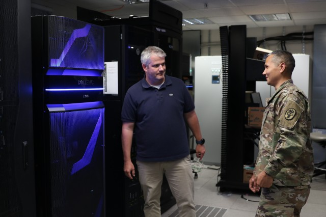 (From left) Jonathan Conway, lead network engineer, Landstuhl Regional Medical Center and U.S. Army Maj. Robert Hjuler, Chief Technology Officer, LRMC, take a look at a network server at LRMC's Information Management Division, Aug. 19. Conway and Hjuler were recently recognized as U.S. Army Medical Department's Health Information Technology Civilian and Officer of the year, respectively.