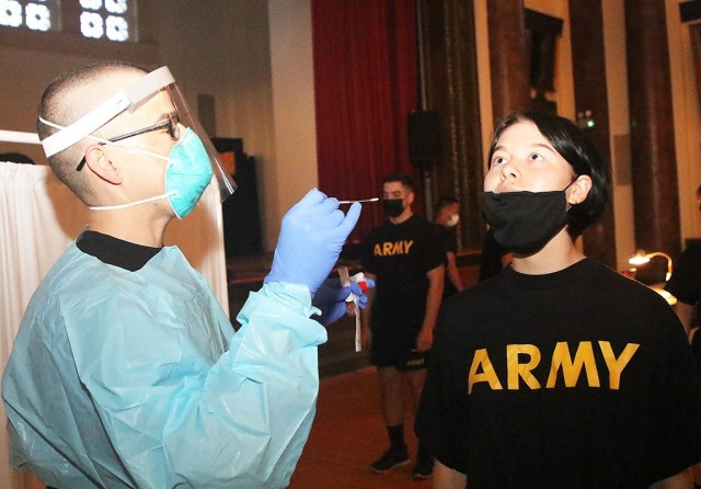 Maj. Ivan Bermudez, instructor in the Math department, prepares to place a swab into the nose of a cadet during COVID-19 surveillance testing Aug. 26 at Cullum Hall.