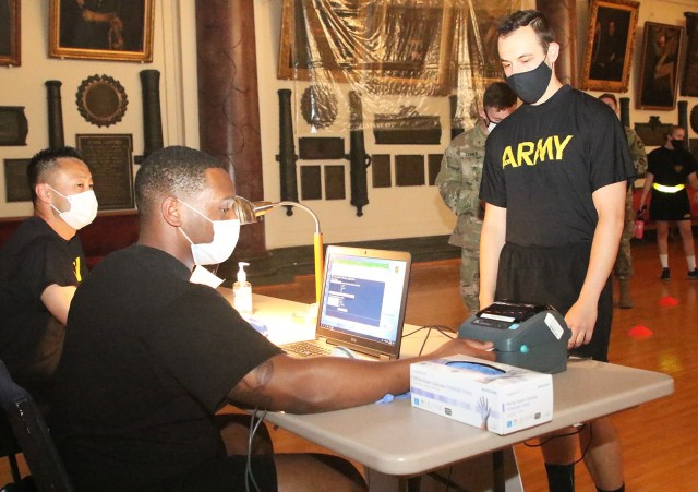 Spc. Lonnie Harris from Keller Army Community Hospital checks the cadets in before they get their COVID-19 surveillance test Aug. 26 at Cullum Hall.