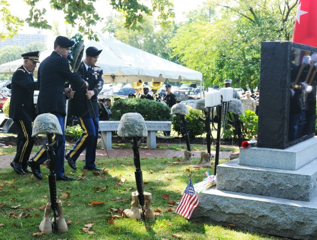 Retired Maj. Gen. George E. Barker directs the laying of the wreath