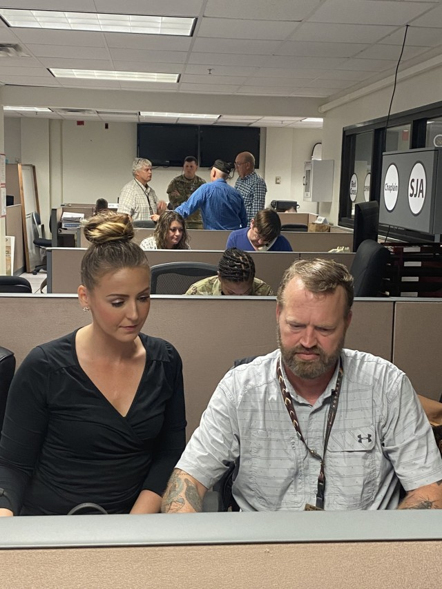 Jessica Ballard (left), Financial Readiness Program manager and Mike Buterbaugh, Mobilization Deployment and Stability Support Operations Program manager, split their time between the Warrior Operations Center and the Family Readiness Center to support Soldiers and their Families impacted by Hurricane Laura.