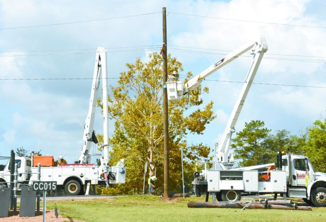 Lineman from several different states made the trip to Louisiana and Fort Polk and worked to restore power in Hurricane Laura's wake, replacing damaged or broken poles and repairing lines.