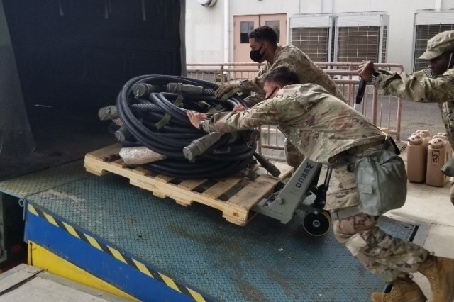 Soldiers with the 563rd Medical Logistics Company's forward logistics element load power distribution cables as part of a field training exercise, held Aug. 15-22 in South Korea. (U.S. Army photo by Staff Sgt. Erik. V. Freeman)