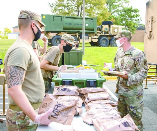 Culinary specialists with the 3rd Brigade Combat Team, 10th Mountain Division, feed fellow Soldiers and their Families following the devastation left by Hurricane Laura, which roared through the Joint Readiness Training Center and Fort Polk during the early morning hours of Aug. 27, packing 130 miles per hour winds.