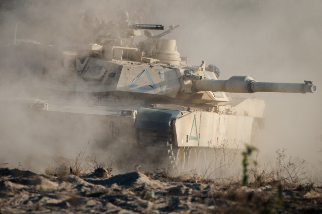 "FORT BENNING, Ga. – In a November 2016 photo, an M1Abrams tank is in action during a competitive maneuver training exercise involving students of Fort Benning's Infantry and Armor basic leadership courses. Such training aids development of a variety of key battlefield skills and capabilities. Those include lethality and leadership, both of which are the focus of the 2020 Virtual Maneuver Warfighter Conference that opened Sept. 9 and ends Sept. 10. This year's official conference theme is ""Delivering Lethality and World-Class Leaders."" To help limit the spread of COVID-19, the conference is being live-streamed. Fort Benning's U.S. Army Maneuver Center of Excellence hosts the conference yearly in its role as institutional center of the Army's Infantry and Armor branches, which together comprise the maneuver force.(U.S. Army photo by Patrick A. Albright, Maneuver Center of Excellence and Fort Benning Public Affairs)"