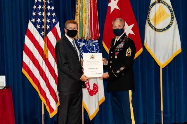 Sgt. Maj. Jeffery (David) Snipes (right) receives his certificate of retirement from CCDC Army Research Laboratory Director Dr. Patrick Baker in an Adelphi Laboratory Center ceremony Sept. 4, 2020.
