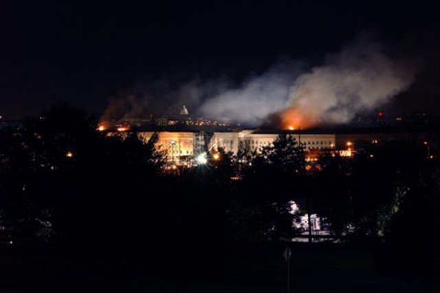 Smoke and flame appear in the Washington skyline in the aftermath of the terrorist attack on the Pentagon, Sept. 11, 2001.