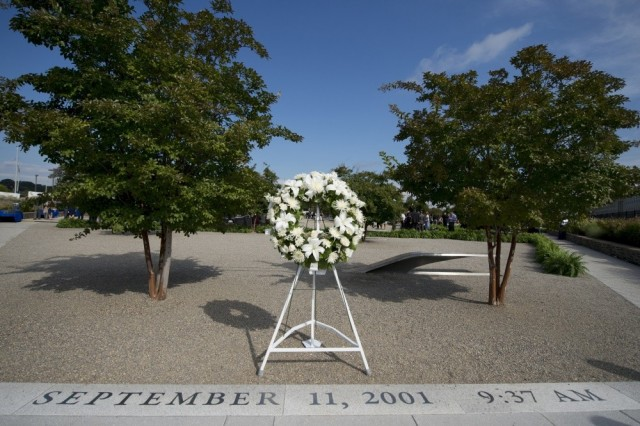 A wreath that was placed by President Barack Obama sits at the entrance of the Pentagon Memorial for the 9/11 Pentagon Observance Ceremony in Washington D.C., Sept. 11, 2014.