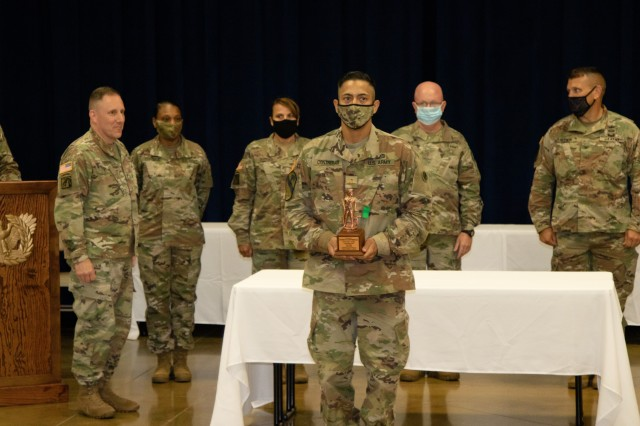 Warrant Officer David Contreras receives the Leadership Award during a pre-graduation reception at Warrant Officer Candidate School, Fort McClellan, Alabama on July 30, 2020. Contreras was selected by his peers to be the recipient of the Leadership Award (National Guard Photo by Staff Sgt. William Frye.)