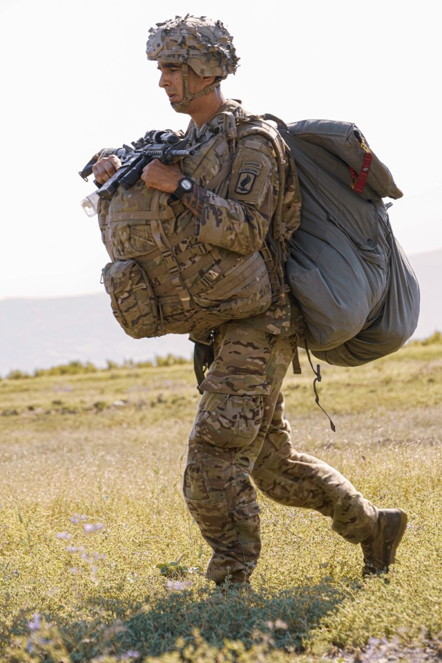 Staff Sgt. Eric Pinson, a U.S. paratrooper assigned to the 173rd Airborne Brigade, moves to the assembly point after completing a successful landing for the unit's airborne assault during the Noble Partner 20 exercise at Vaziani Training Area, Georgia, Sept. 1, 2020. Exercise Noble Partner is designed to enhance regional partnerships and increase U.S. force readiness and interoperability in a realistic, multinational training environment. The exercise allows participants to conduct airborne operations, situational training exercises, live-fire exercises and combined mechanized maneuvers.