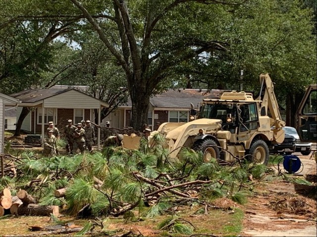 Volunteers pitched in to remove debris left in Hurricane Laura's wake on Fort Polk.