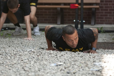 Master Sgt. Felipe Pacheco pushes up to perform a burpee during a circuit style physical training session in Coraopolis, Pa., Aug. 6, 2020. Pacheco is a Master Fitness Trainer, is Army Combat Fitness Level 4 certified and served as the instructor for the group of U.S. Army Reserve Soldiers practicing for the Army Combat Fitness Test.