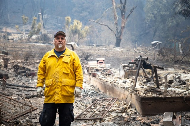 Presidio of Monterey firefighter, David Serna, stands in the rubble that was once his home. The CZU Lightning Complex Fire burned down his home Aug. 19 in the Santa Cruz Mountains.