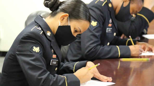 Spc. Denise Ann-Marie Duque, G-1 Office, 311th SC (T), completed a written test and essay during the 311th Signal Command (Theater) Best Warrior Competition, July 27-29. Eight of the command's Soldiers vied for the top spots as this year's Soldier of the year, NCO of the year and Army Reserve Soldier of the year.