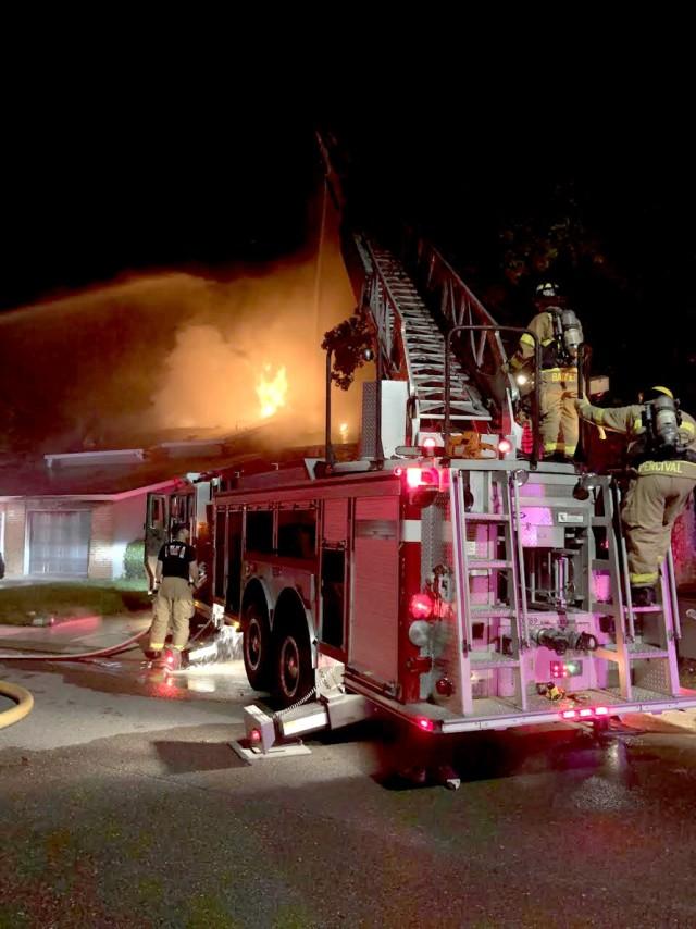 Fort Polk DES firefighters use a ladder engine truck to  battle a house fire on Fort Polk Sept. 7.